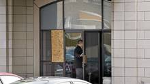 A man enters a funeral home owned by the Rizzuto family that was firebombed overnight Thursday, January 6, 2011 in Montreal. (Paul Chiasson/The Canadian Press/Paul Chiasson/The Canadian Press)
