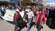 "Demonstrators march against violence in Juliaca, southern Peru, on June 25, 2010. Canada's Bear Creek Mining Corp. said it will use ""all available avenues"" to insist on its right to open a silver mine in the mountains of southeastern Peru, after authorities suspended its concession. (AFP/Getty Images)"