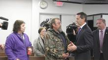 Former Ontario premier Dalton McGuinty talks to Darrin Latulippe and his wife Teresa Perizzolo, daughter of mall victim Doloris Perizzolo, at the mall-collapse inquiry in Elliot Lake, Ont., on Wednesday, Oct. 9, 2013. (Colin Perkel/THE CANADIAN PRESS)