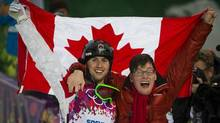 Alex Bilodeau pose with his brother Frederic after winning gold in the men's freestyle moguls event at the Sochi Winter Olympics (John Lehmann/The Globe and Mail)