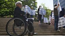 Lawyer Joseph Arvay waits to talk to the media as members of the Euthanasia Prevention Coalition protest outside the British Columbia Supreme Court in Vancouver on June 15, 2012. (ANDY CLARK/REUTERS)