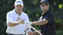 Caddy Steve Williams and golfer Adam Scott