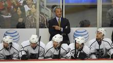LA Kings head coach Darryl Sutter on the bench during a game against the Chicago Blackhawks in the first period of their NHL game in Chicago, Monday, March 25, 2013. (David Banks/AP)