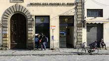 People use a cash machine of Monte Paschi in Florence, Italy, in 2016. Five months after the bank requested help, there is yet to be a final agreement on how Monte Paschi should be restructured. (TONY GENTILE/REUTERS)