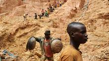 Workers dig at a gold mine in Chudja, near Bunia, north eastern Congo. The conflict in the Congo has often been linked to a struggle for control over its minerals resources. The Congo is rich in mineral resources such as gold, diamonds, tin, and cobalt. (LIONEL HEALING)