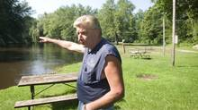 Marc LeBlanc of Shady Bend Campground in Augusta, Mich., gestures on Sunday toward the banks of the Kalamazoo River, which has been contaminated by more than three million litres of crude oil. (Kevin van Paassen/The Globe and Mail)