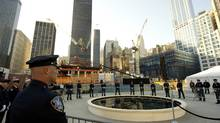 Police and firefighters surround the reflecting pool at the World Trade Center site during 9/11 remembrance ceremonies in New York, September 11, 2010. (POOL/Don Emmert/Reuters)