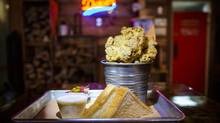 Fried Chicken Bucket with country gravy at Dixies BBQ in Vancouver September 22, 2016. (John Lehmann/The Globe and Mail)