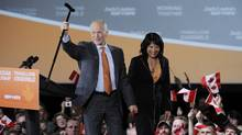 Canada's New Democratic Party (NDP) leader Jack Layton and his wife Olivia Chow greet supporters at his federal election night headquarters in Toronto, May 2, 2011. (Mark Blinch/Reuters/Mark Blinch/Reuters)