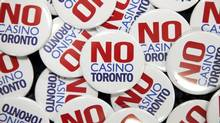 """No Casino Toronto"" buttons were handed out by Maureen Lynett, Sheila Lynett, and Peggy Calvert during a casino consultation event at Toronto City Hall on Wednesday. (MATTHEW SHERWOOD FOR THE GLOBE AND MAIL)"