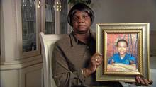 Lorna Brown holds a photo of her son Ephraim, who was killed in handgun crossfire in Toronto. From Kevin Newman's documentary Missing the Target.