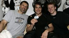 Teemu Selanne #8 of the Anaheim Ducks poses with the puck and teammates who assisted his 600th career goal, Scott Niedermayer #27 and Corey Perry #10 that he made during the game against of the Colorado Avalanche on March 21, 2010 at Honda Center in Anaheim, California. (Photo by Debora Robinson/NHLI via Getty Images) (Victor Decolongon/2010 Getty Images)