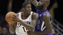 Cleveland Cavaliers' Anthony Bennett, left, tries to get past Sacramento Kings' Quincy Acy during the third quarter of an NBA basketball game Feb. 11, 2014, in Cleveland. Bennett scored 19 points and grabbed 10 rebounds in the Cavaliers' 109-99 win. (Mark Duncan/AP)