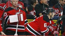 New Jersey Devils' goalie Martin Brodeur watches from the bench after he was pulled from the game in the final minute for an added skater against the Philadelphia Flyers (Rich Schultz/The Associated Press)