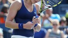 Eugenie Bouchard, of Canada, reacts after a shot against Ekaterina Makarova, of Russia, during the fourth round of the 2014 U.S. Open tennis tournament, Monday, Sept. 1, 2014, in New York. (John Minchillo/AP)