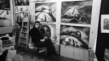 H.R. Giger with some of his sketches for Alejandro Jodorowsky's proposed but never completed 1970s adaptation of the sci-fi classic Dune. (Sony Pictures Classics)