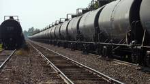 Dozens of tanker cars similar to the model used for the train that crashed in Lac-Megantic, Que., are parked on Monday, July 16, on the train's line near Farnham, Que. (Les Perreaux/The Globe and Mail)