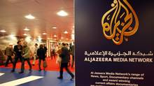 The logo of Al Jazeera Media Network is seen at the MIPTV, the International Television Programs Market, in Cannes April 2, 2012. (ERIC GAILLARD/REUTERS)