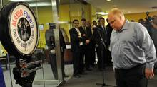 Toronto Mayor Rob Ford heads for the scale during his a weigh-in at City Hall on April 6, 2012. (Fred Lum/Fred Lum/The Globe and Mail)
