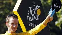 Sky Procycling rider and leader's yellow jersey Bradley Wiggins of Britain celebrates his overall victory on the podium after the final 20th stage of the 99th Tour de France cycling race between Rambouillet and Paris, July 22, 2012. (STEPHANE MAHE/REUTERS)