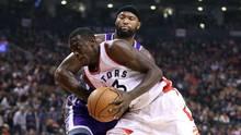 Raptors forward Pascal Siakam goes to the basket against Sacramento Kings forward DeMarcus Cousins. (Tom Szczerbowski/USA Today Sports)
