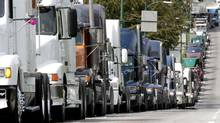 A labour dispute like the one in 2005 between truckers and Port Metro Vancouver is what the three parties are hoping to avoid today. (Chuck Stoody/The Canadian Press)