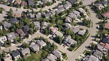 Calgary's real estate picture continues to diverge from the hot markets in Toronto and Vancouver with a 20th consecutive month of declining home sales in July. (Jonathan Hayward/THE CANADIAN PRESS)