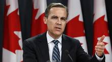 Bank of Canada Governor Mark Carney speaks during a news conference upon the release of the Monetary Policy Report in Ottawa January 18, 2012. (© Chris Wattie / Reuters/REUTERS)