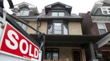 A house with a sold sign is seen in Toronto on Wednesday, February 15, 2012. (Matthew Sherwood/Matthew Sherwood/For The Globe and Mail)