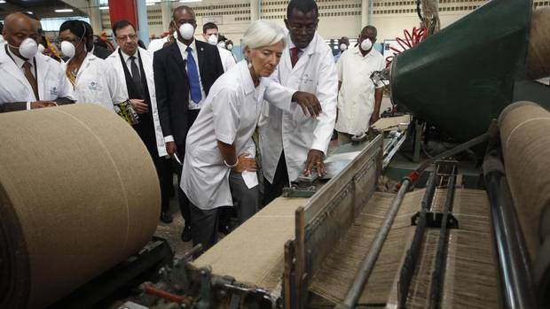 Christine Lagarde, managing director of the International Monetary Fund, views high-speed looms at the Filtisac bag factory in Abidjan, Ivory Coast, Jan. 8, 2013. (THIERRY GOUEGNON/Reuters)