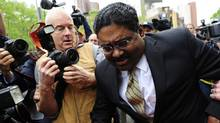 Former hedge fund founder Raj Rajaratnam leaves court after he was convicted on all counts of fraud and conspiracy in Wall Street's biggest insider trading trial for years, in New York, on May 11, 2011. (EMMANUEL DUNAND)