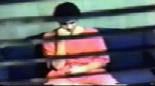 Omar Khadr is shown in an interrogation room at the Guatanamo U.S. Naval Base prison while being question by CSIS, in this image taken from a 2003 surveillance video, release by his Canadian defense team on Tuesday July 15, 2008.