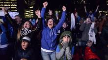 Toronto Blue Jays fans celebrate in Nathan Phillips Square after the Toronto Blue Jays won against the Texas Rangers in ALDS game five playoff baseball action in Toronto on Wednesday, October 14, 2015. (Marta Iwanek/THE CANADIAN PRESS)
