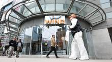 Pedestrians walk past a Wind Mobile location in Toronto on Tuesday, May 5, 2015. (Darren Calabrese For The Globe and Mail)