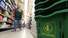 Shoppers at the Dollarama store on Spadina Avenue in Toronto on June 13, 2012. (Deborah Baic/The Globe and Mail)