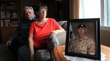 Micheline and Phillip Reed with a photograph of their son, Corporal Anthony A. Reed on October 22, 2016 in Ottawa. Anthony died of post-traumatic stress disorder at CFB Petawawa, Ont., in December, 2012. (Dave Chan/THE GLOBE AND MAIL)