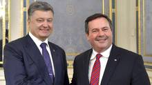 This handout picture taken and released by the Ukrainian Presidential press-service shows Ukrainian President Petro Poroshenko (L) shaking hands with Canadadian Minister of National Defence and Minister for Multiculturalism Jason Kenney as he welcomes him prior to talks in Kiev on June 26, 2015. (MYKOLA LAZARENKO/AFP/Getty Images)