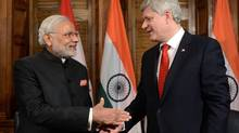 Indian Prime Minister Narendra Modi takes part in a meeting with Prime Minister Stephen Harper in his office on Parliament Hill in Ottawa on Wednesday, April 15, 2015. (Sean Kilpatrick/THE CANADIAN PRESS)