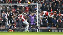 Arsenal's Alexis Sanchez, right, heads a ball toward the goal during Sunday's game against Leicester City at Emirates Stadium. (Darren Staples/REUTERS)