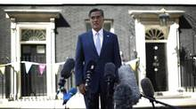U.S. Republican presidential candidate Mitt Romney speaks to the press after his meetings with Britain's Prime Minister David Cameron and Chancellor of the Exchequer George Osborne in London on Thursday. (JASON REED/Reuters)