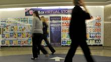 Well.ca's virtual store in a Toronto subway station allows consumers to purchase items using a smartphone and have them delivered to their homes. (Fred Lum/The Globe and Mail/Fred Lum/The Globe and Mail)