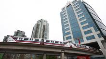The Skytrain travels underneath Vancity Credit Union headquarters in Vancouver, June 5, 2012. Mayor Gregor Robertson has distanced himself from municipal colleagues on the question of a transit referendum. (Jeff Vinnick For The Globe and Mail)