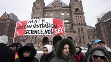 Demonstrators gather in front of Queen's Park to protest against Ontario's new sex education curriculum in Toronto on Tuesday, February 24, 2015. (Darren Calabrese/THE CANADIAN PRESS)