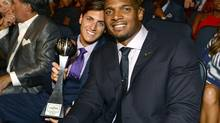 Vito Cammisano, left, and Michael Sam pose in the audience at the ESPY Awards at the Nokia Theatre on Wednesday, July 16, 2014, in Los Angeles. (Jordan Strauss/Jordan Strauss/Invision/AP)