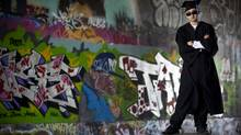 Graduate Justin Tolentino stands at a tunnel decorated with his graffiti. He had been kicked out of 10 different high schools. (JOHN LEHMANN/John Lehmann/The Globe and Mail)