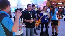 E3 attendees play Nintendo's new Super Mario Bros. game on the Wii U. The closer you get to the Wii U experience the better you feel about the console's future. (Chad Sapieha for The Globe and Mail)