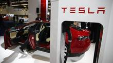 Shares of Tesla Motors are trading 11 per cent higher following its July 31 release of quarterly earnings. (Kai Pfaffenbach/Reuters)