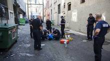 First responders attend a medical call in Vancouver's Downtown Eastside in September. (Rafal Gerszak/The Globe and Mail)