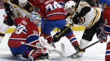 Montreal Canadiens goalie Peter Budaj (30) makes a save on Boston Bruins forward Patrice Bergeron (37) during the first period at the Bell Centre. (Eric Bolte/USA Today Sports)