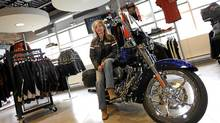 Concord, 28/09/11 - Mary Testani, Senior Manager, Business Systems with Deeley, Harley-Davidson Canada, poses for a photo on one of the motorcycles in the office showroom in Concord, Ont. (Deborah Baic/Deborah Baic/The Globe and Mail)